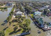 56 Lazy Lane, Kemah, TX 77565 - Image 1: What a rare chance to find more than 270 degrees of unobstructed view in Clear Lake. This beautiful Waterfront property has so many options. Build your custom dream home, or speculate on  two additional homes on the property.