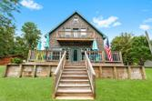 244 W Village Cove Loop, Livingston, TX 77351 - Image 1: This is the sweet lake cottage you have been looking for