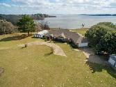 205 Skains, Trinity, TX 75862 - Image 1: This could be your tranquil, private Lake Front Ranch retreat on Lake Livingston.