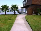844 Beachwalk Boulevard, Conroe, TX 77304 - Image 1: Walking up to the Lake Conroe Boathouse entrance