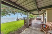 500 Weavers Cove, Livingston, TX 77351 - Image 1: Relax after dinner on your covered deck with a cool beverage and enjoy the soothing sounds of the water lapping at the bulkhead.  Your Boat House and Slip can be seen in the background.