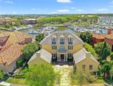 19 Waterford Oaks Lane, League City, TX 77565 - Image 1: Welcome to 19 Waterford Oaks, a stunning waterfront manor designed for the seller to accommodate her antiques and architectural finds.