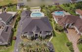 1907 Ray Shell Court, Seabrook, TX 77586 - Image 1: An aerial view of the home showing the gorgeous mature palms lining the front of the home as well as the wonderful pool in the backyard located at the end of the canal.