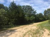 150/152 Dogwood Circle, Hilltop Lakes, TX 77871 - Image 1: Lots start at white stake just visible in picture.