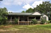 6654 FM 3126, Livingston, TX 77351 - Image 1: Lakeside of home with covered porch