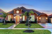 628 Appia Drive, League City, TX 77565 - Image 1: BEAUTIFUL 1 STORY AT TWILIGHT.  ENJOY A RARE 1 STORY NEW CONSTRUCTION ON THE WATER COMPLETE WITH BOATHOUSE!