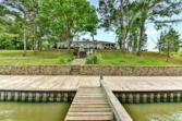 754 Shoreline Drive, Livingston, TX 77351 - Image 1: Large Waterfront lot and home with grand views of the Lake. Nicely landscaped.  Beautiful Stone Retaining Walls provide a more gentle slope to the lake.