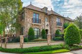 2718 Timberloch Place, The Woodlands, TX 77380 - Image 1: This corner lot features custom designed andprofessionally landscapped yard, front and back.Custom gas lanterns made in New Orleans andMirabella iron door with Flemish glass top.