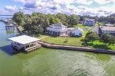 588 Indian Shore Shore, Livingston, TX 77351 - Image 1: Wonder waterfront lot and half with Fenced Yard, large newer boathouse, sidewalk along metal bulkhead.