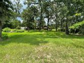 438 Lazy Lane, Livingston, TX 77351 - Image 1: UNRESTRICTED ... 1/4 mile from Lake Livingston on OLD Highway 190 / FM 2457 !  Used to be part of Indian Hills, but new survey confirms ... Unrestricted.  Awesome opportunity for Commercial Access.