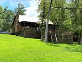 337 Indian Creek Drive, Coldspring, TX 77331 - Image 1: Log Cabin rest high on this half acre lot with panoramic views of the lake