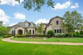 31251 Riverlake Road, Fulshear, TX 77441 - Image 1: Presenting this luxury stone and stucco Tuscan Estate in much sought after FULBROOK.  Located on 1.47 Acres on Oxbow Lake with majestic trees and lush landscaping, the property offers peaceful and spectacular views.  Truly Exquisite!