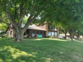2810 Breezy Heights Dr, Wahpeton, IA 51351 - Image 1: House facing the water