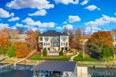 621 Forestridge Lane, Villages, MO 65079 - Image 1: Gentle to the waters edge, this home is beautiful in every season.