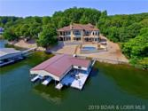 27616 South Majestic Road, Gravois Mills, MO 65037 - Image 1: This beautiful home includes the dock, a pool, hot tub, and expansive decks that allow you to enjoy the full breadth of what the lake has to offer.