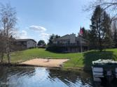 8388 Peninsula E Drive, Canadian Lakes, MI 49346 - Image 1: Brown