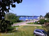 Lot 2 W Monroe Road, Pentwater, MI 49449 - Image 1: Watching the sailboats
