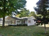 14134 Houser Street, Bear Lake, MI 49614 - Image 1: Tall shade trees and a double lot
