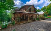 1300 FISH HOOK POINT, Blue Ridge, GA 30513 - Image 1: Timeless stacked stone pillars with top tier craftmanship creating your perfect mountain home
