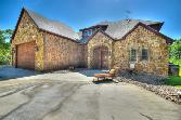 227 Grand Harbor Drive Lot 64, Chico, TX 76431 - Image 1: Beautiful rock and brick exterior with 3-car garage.