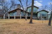 303 Shoreline Drive, Gainesville, TX 76240 - Image 1: All decks are Trex.  Beautiful views from almost every room with decks & screened in porches.
