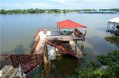 8877 Random Road Lot 3, Fort Worth, TX 76179 - Image 1: 2 story dock with a boat lift and jet ski lifts. Great party deck up top with a beautiful view.