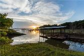 346 Tuttle Circle Lot 57, Pottsboro, TX 75076 - Image 1: Boathouse with 2 slips convey with the sale of house. Look at the beautiful sunset!