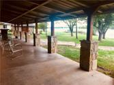 1814 Beavers Point, Bonham, TX 75418 - Image 1: Imagine gazing at a beautiful sunset while sitting on this incredible covered patio that spans the width of the home!