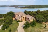 199 Grand Harbor Boulevard, Chico, TX 76431 - Image 1: Lake Bridgeport Custom on 1.382 acres with 3 Car Garage and  Double Decker Floating Boat Dock!