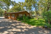 484 Briggs Boulevard, East Tawakoni, TX 75472 - Image 1: Lake front home surrounded by manicured grounds.