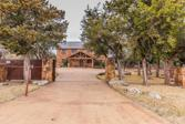 5033 Hells Gate Loop, Possum Kingdom Lake, TX 76475 - Image 1: Welcome home! This custom home sits behind a private secured gate with manicured lawn and trees.