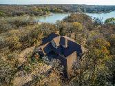 1241 Emerald Sound Court Lot 182, Oak Point, TX 75068 - Image 1: Beautifully placed home on Lake Lewisville. Lots of trees to enjoy the wildlife and landscaped setting for amazing views.