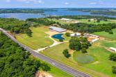 7639 US Highway 377, Collinsville, TX 76233 - Image 1: PROPERTY AERIAL...Amazing Horse Ranch With Great Visibility On Hwy 377 In Collinsville! Nice Home, Large Cvrd Arena W/Lounge Or Apt, 28-Stall Main Barn, 6-Stall Mare Barn, 4-Stall Shed Row Barn And Much More. A Must See!  Property Outlines Are Approximate
