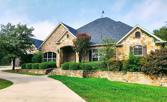 1550 Country Club Road, Bowie, TX 76230 - Image 1: Front of house.  Mature landscaping and circle driveway