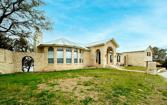 1021 Western Hills Court, Granbury, TX 76049 - Image 1: This home takes up almost the whole Cul de sac! Sprinker system in front and aerobic septic will keep your lawn looking great. Austin stone throughout for added charm!