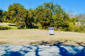 7412 Apache Trail, Lake Worth, TX 76135 - Image 1: Large .49 acre lot with lots of potential to build your dream home around wildlife, trees, ponds, creeks and close to Lake Worth Lake.