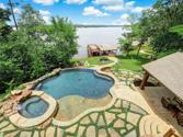 350 E Eldorado Drive, Scroggins, TX 75480 - Image 1: A home with a million dollar view!  Infinity edge pool with spa has multiple waterfall features and swim deck! Bug mister system covers home exterior and boathouse.