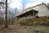 10400 Cedar Rock  RD, Garfield, AR 72732 - Image 1: Back of house with spacious deck overlooking Beaver Lake