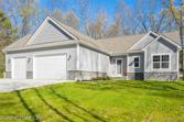 2955 CADY, Brighton Twp, MI 48114 - Image 1: Stone ledge in grey and coordinating grey vinyl siding. Totally makes this home a maintenance free exterior for many years to come..