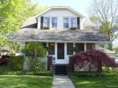 354 E BROOKS Street, Howell, MI 48843 - Image 1: Great curb appeal with screened front porch to enjoy relaxed evenings.