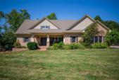 332 Leeward Drive, Stokesdale, NC 27357 - Image 1: Lake living at it's best!  Quality and charm are evident in this lake front home with approximately 156 of water frontage.  The construction of this home was done with every conceivable bell and whistle!