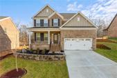 6004 Bedstone Drive, Greensboro, NC 27455 - Image 1: Beautiful home with covered front porch and raised landscaped bed.