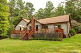 784 Merifield Drive, Clarksville, VA 23927 - Image 1: cedar sided ranch is nicely tucked into the 1.8 acre lot