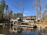 677 Sagamore Drive, Louisburg, NC 27549 - Image 1: Builders own 2016 Lake Front Home Nestled gently on a large deep cove - Meticulously Maintained and Better Than New...Lots of Curb Appeal from Road and Water, with boat house, covered party area and deck., Cute as a Button Loaded Water Front Ranch