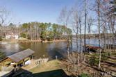 583 Sagamore Drive, Louisburg, NC 27549 - Image 1: 6,000 sq ft, Gourmet Chef Kitchen, Awesome Master Suite Heated Floors, 3 Stories, elevator, 5 baths, flex rooms, Game Room, Soundproofed Media Room, Craft Room, Heated/Cooled Work Shop, Exercise Room, Too much to list, One of a Kind Water Front Estate