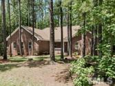 102 Hatchet Drive, Louisburg, NC 27549 - Image 1: This beautiful brick ranch home has a large side-load garage and sits on a private 0.4 acre lot surrounded by woods!