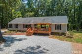 3072 Farm Road, Bullock, NC 27507 - Image 1: decks on the front and rear to relax and enjoy your land and the outdoors!The above ground pool can remain if you would like it., Exterior Back