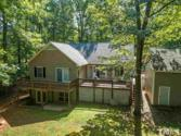 9563 Whippoorwill Ridge Road, Bullock, NC 27507 - Image 1: your own private dock in good water awaits- nice easy slope to the lake