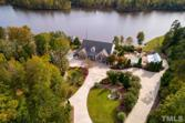 130 Crystal Bay Road, Semora, NC 27343-9098 - Image 1: Past the pool deck are a green house and garden, awaiting a green-thumb., Aerial View of Pool
