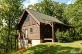 371 Olde Forest Road, Clarksville, VA 23927 - Image 1: Lakeside of the custom log home w/ 3 finished levels